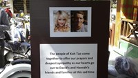 Pictures of killed British tourists David Miller and Hannah Witheridge and a message of support to their friends and families are displayed during special prayers at Koh Tao island September 18, 2014.
