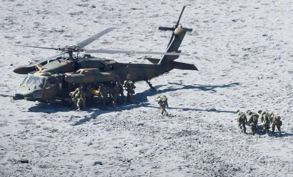 Japan Self-Defense Force (JSDF) soldiers conduct rescue operations near the peak of Mt. Ontake, which straddles Nagano and Gifu prefectures, central Japan October 1, 2014, in this photo taken and released by Kyodo.