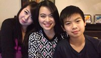 Nguyen Ngoc Minh (C) and her daughter Dang Minh Chau (L) and son Dang Quoc Huy in a photo provided by family.