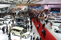 Visitors inspect vehicles during the Indonesia International Motor Show in Jakarta, Indonesia, on Thursday, Sept. 18, 2014.