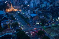 The Sule pagoda, left, and residential properties stand at dusk in Yangon, Myanmar. The lenders are among foreign companies seeking to gain a foothold in Myanmar as the nation reconnects with the global economy following 50 years of military rule.
