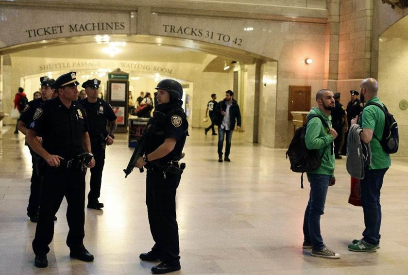 New York City Police officers stand at the stand guard inside Grand Central Station on September 25, 2014 in New York
