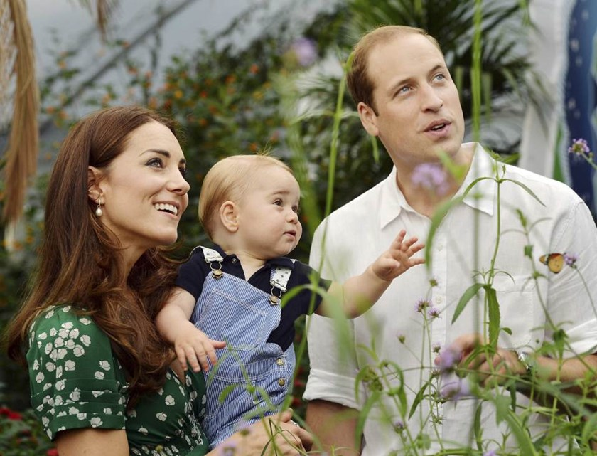Britain's Catherine, Duchess of Cambridge, carries her son Prince George alongside her husband Prince William as they visit the Sensational Butterflies exhibition at the Natural History Museum in London, July 2, 2014. Prince George celebrates his first bi
