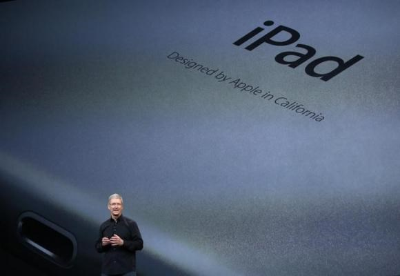 Apple Inc CEO Tim Cook speaks about the new iPad Air during an Apple event in San Francisco, California October 22, 2013.