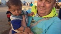 An undated family handout photo of British aid worker Alan Henning taken at a refugee camp on the Turkish-Syria border.