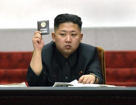 North Korean leader Kim Jong-Un holds up his ballot during the fifth session of the 12th Supreme People's Assembly of North Korea at the Mansudae Assembly Hall in Pyongyang in this April 13, 2012 file photo released by the North's KCNA on April 14, 2012.