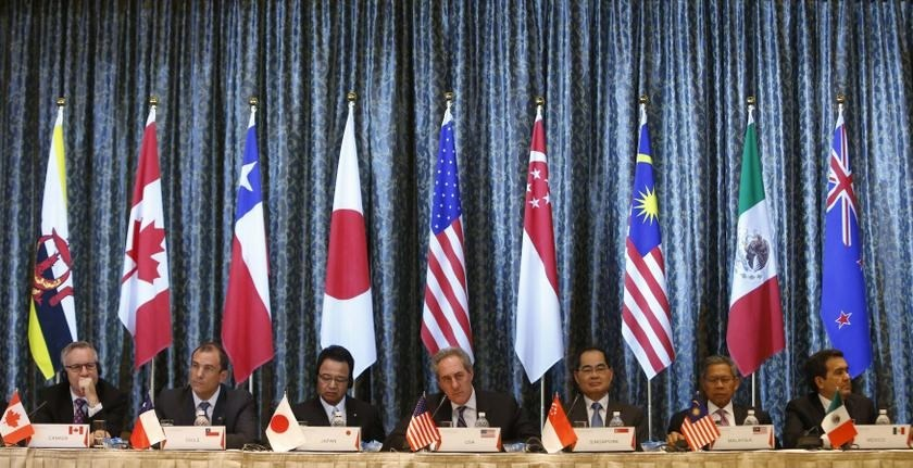 US Trade Representative Michael Froman (centre) speaks during a news conference of the Trans-Pacific Partnership (TPP) Ministerial meeting in Singapore February 25, 2014. Photo: Reuters