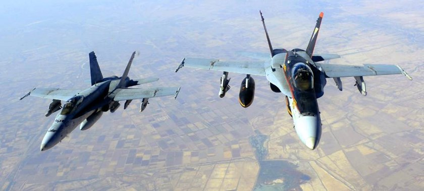 This October 4, 2014 image from the US Navy shows two F-18E Super Hornets supporting operations against IS, after being refueled over Iraq after conducting an airstrike