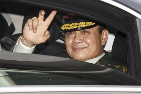 Thailand's Prime Minister Prayuth Chan-ocha gestures to the media as he leaves after a handover ceremony for the new Royal Thai Army Chief, General Udomdej Sitabutra, at the Thai Army Headquarters in Bangkok September 30, 2014.