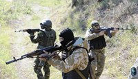 Servicemen of the pro-Ukrainian St. Maria battalion take part in a drill near the eastern Ukrainian city of Mariupol on October 8, 2014