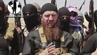Islamic State Commander Omar al-Shishani, center, is seen in this video image dated June 28, 2014, and posted on a social media account frequently used for communications by the Islamic State of Iraq and the Levant (ISIL).