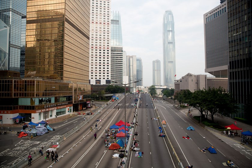 Demonstrators gather on Connaught Road outside the Central Government Offices in Hong Kong on Oct. 9, 2014.