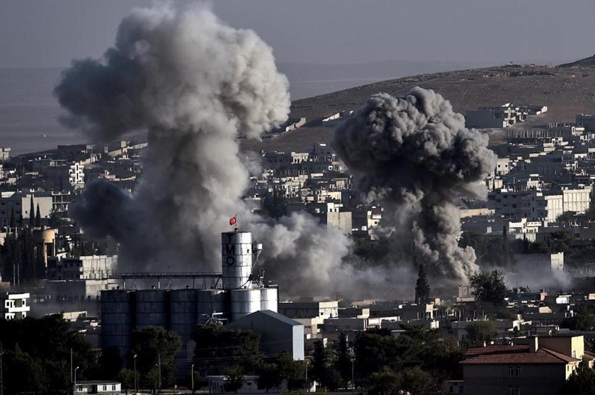 Smoke rises after strikes by aircraft from the US-led coalition on the Syrian town of Ain al-Arab, known as Kobane by the Kurds, in the southeastern village of Mursitpinar, Sanliurfa province, on October 10, 2014