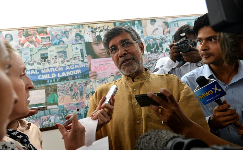 Indian activist Kailash Satyarthi talks to journalists at this home office after the announcement of him receiving the Nobel Peace Prize, in New Delhi, on Oct. 10, 2014.