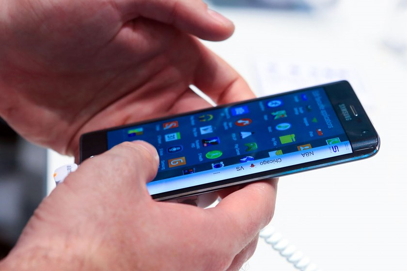 A visitor inspects a Samsung Galaxy Note Edge smartphone at the IFA Consumer Electronics Show in Berlin, Germany.