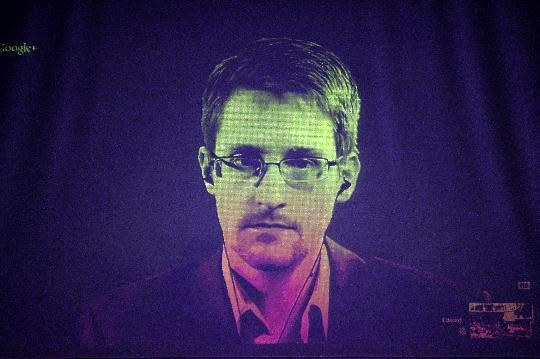 File photo taken on June 24, 2014 shows US whistleblower Edward Snowden speaking to European officials via videoconference during a parliamentary hearing at the Council of Europe in Strasbourg, eastern France
