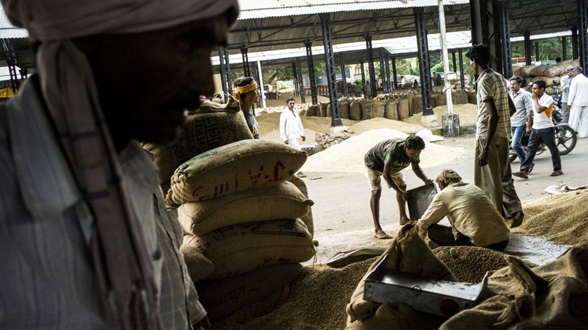 Farmers pack soybeans into sacks in Burhanpur, Madhya Pradesh, India. Madhya Pradesh is one of four Indian states where agriculture accounts for more than 20 percent of gross domestic product, according to an HSBC report last month.