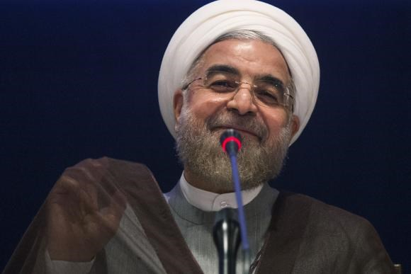 Iran's President Hassan Rouhani smiles while replying to a question during a news conference on the sidelines of the 69th United Nations General Assembly at United Nations Headquarters in New York September 26, 2014.