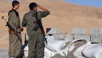 Kurdistan Workers Party fighters guard a post as they participate in an intensive security deployment against Islamic State militants in the town of Makhmur, southwest Arbil, the capital of the autonomous Kurdish region of northern Iraq, on Aug. 21, 2014.
