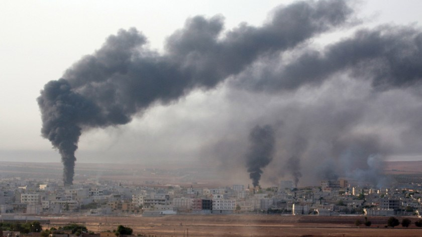 Smoke rises after U.S. airstrikes against Islamic State, in Kobani, Syria, on Oct. 13, 2014.