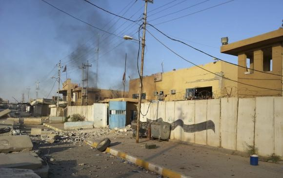A damaged police station is seen in the Anbar province town of Hit October 6, 2014.