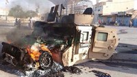 An Iraqi military vehicle burns after an attack by the militant Islamic State group, in western Anbar province, on Sunday, Oct. 5, 2014. Though the group has been in areas to the west of Baghdad for months, recent advances have sparked concern it's prepar