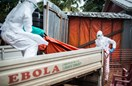 Liberian health workers carry an ebola victim who died over night at the ELWA 3 Ebola treatment center in Paynesville outside Monrovia, Liberia, on Oct. 13, 2014.