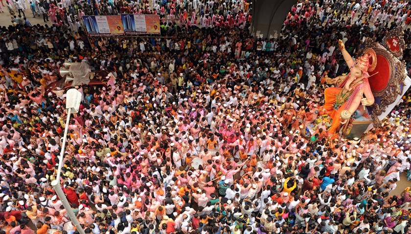 Indian devotees throng the streets next to Hindu god Lord Ganesha during a procession for an immersion in Mumbai on Sept. 8, 2014.