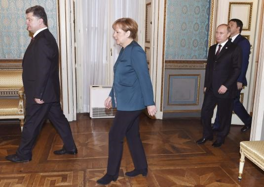 (L to R) Ukraine's President Petro Poroshenko, German Chancellor Angela Merkel, Russia's President Vladimir Putin and Italy's Prime Minister Matteo Renzi arrive for a meeting on the sidelines of a Europe-Asia summit (ASEM) in Milan October 17, 2014.