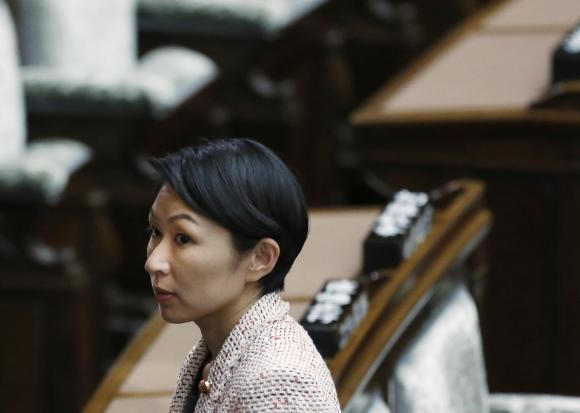 Japan's Economy, Trade and Industry Minister Yuko Obuchi leaves the upper house of parliament in Tokyo September 29, 2014.