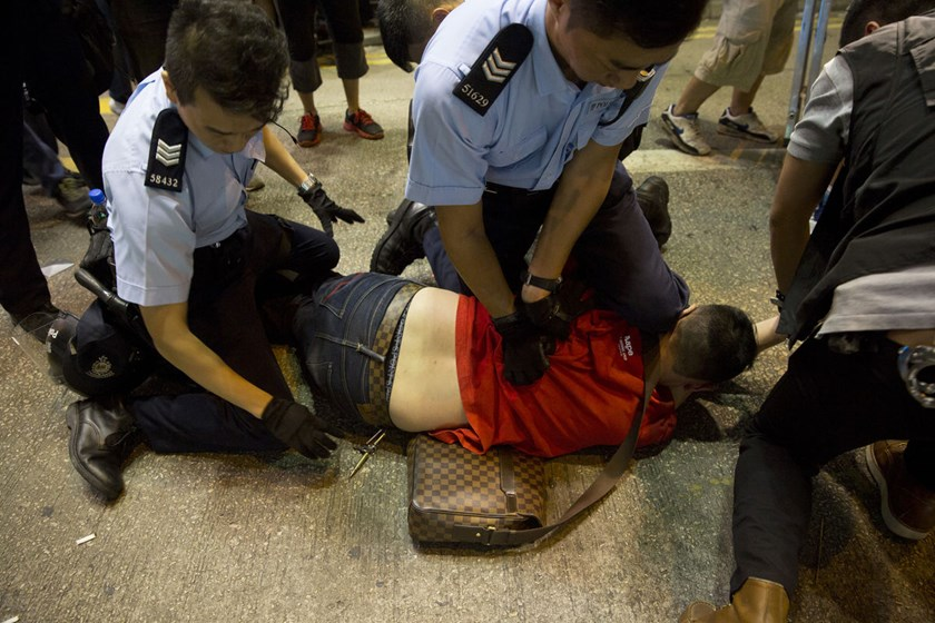 A demonstrator is arrested by police officers on Argyle Street in the Mong Kok area of Hong Kong on Oct. 17, 2014.