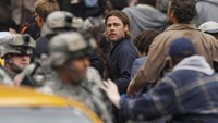 Actor Brad Pitt looks back as he runs during the filming of zombie movie 'World War Z' in Glasgow, Scotland August 24, 2011.