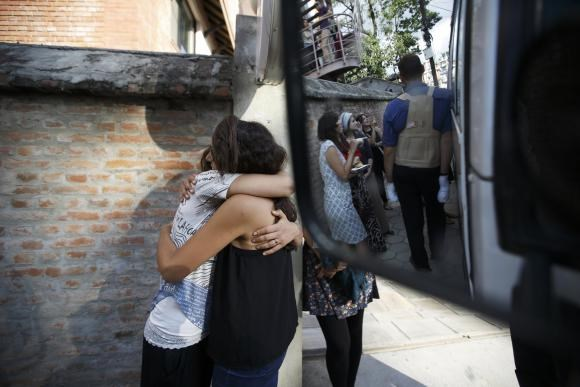 Israeli survivors from the blizzard hug each other, as they get ready to board a bus to the airport to head back to their country in Kathmandu October 18, 2014.