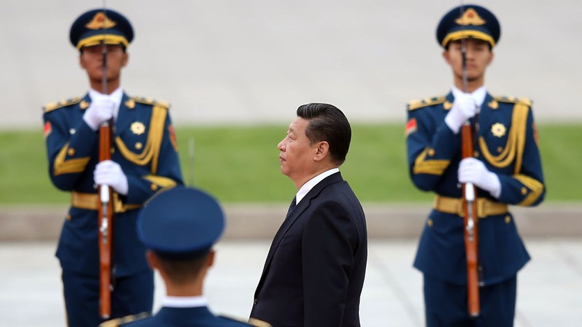 Chinese President Xi Jinping walks past honor guards at the Monument to the People's Heroes during a ceremony at Tiananmen Square in Beijing, on Sept. 30, 2014.