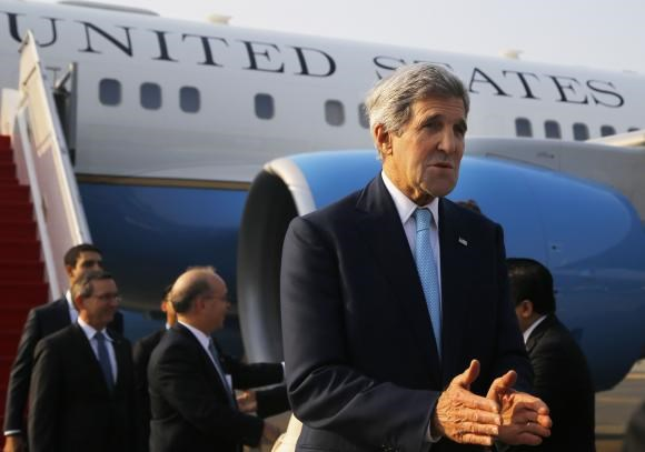 United States Secretary of State John Kerry arrives at the airport in Jakarta October 20, 2014, for the inauguration of President of Indonesia Joko Widodo and meetings with other regional leaders.