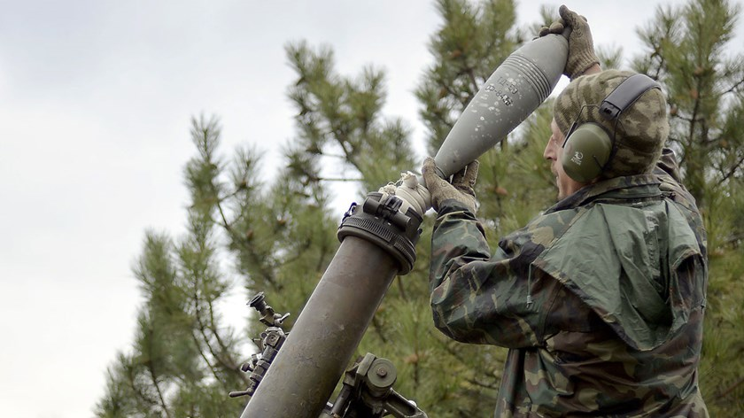 A Ukrainian serviceman loads a mortar in the village of Peski, near town of Donetsk, on Oct. 18, 2014.