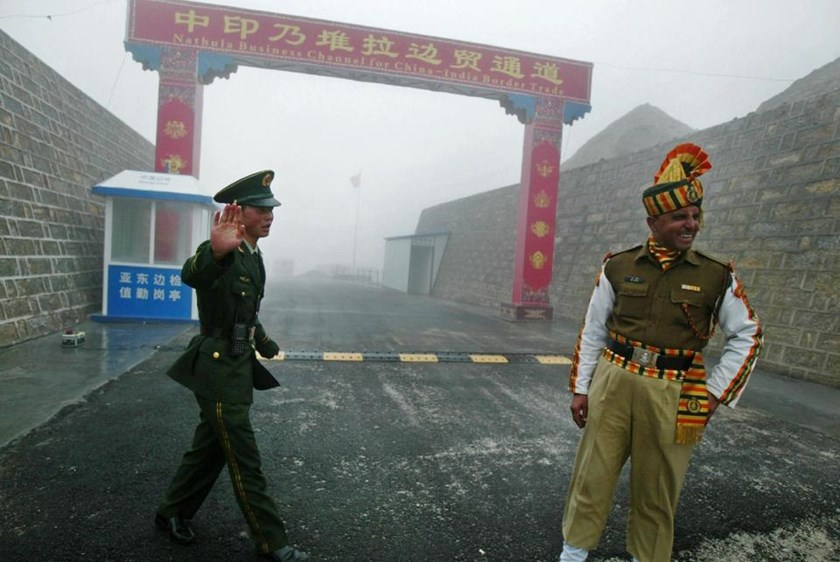 A Chinese soldier (left) and his Indian counterpart at the ancient Nathu La border crossing that remained closed for 44 years after the two Asian countries fought a bitter war in 1962