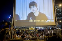 Hong Kong considers report on democracy demands to China