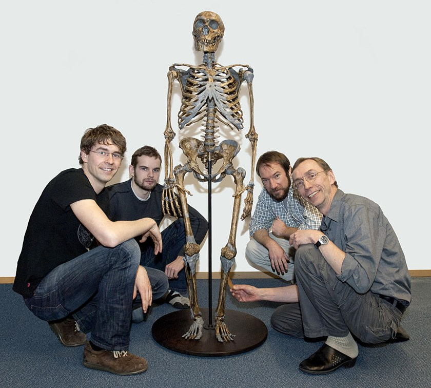 In this undated image, (L-R) Svante Paabo, who headed the recent study, Ed Green, Adrian Briggs and Johannes Krause, pose with a Neanderthal skeleton in Leipzig