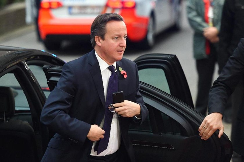 Prime Minister David Cameron arrives for a European Union summit at the EU headquarters in Brussels on October 24, 2014