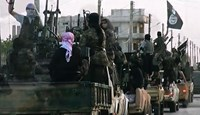 Image grab from a propoganda video shows Islamic State fighters driving through the city of Homs, in Syria in March 2014