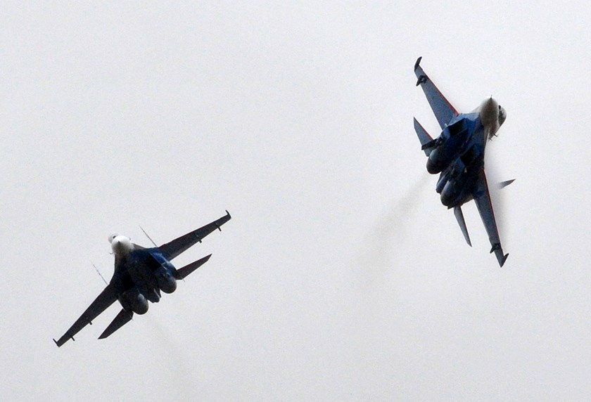 Two Sukhoi Su-27 fighters perform during celebrations of the 10th anniversary of the Russian air force base of the Collective Security Treaty Organization (CSTO) in Kant, about 20 km outside Bishkek, in this Oct. 27, 2013 file photo.