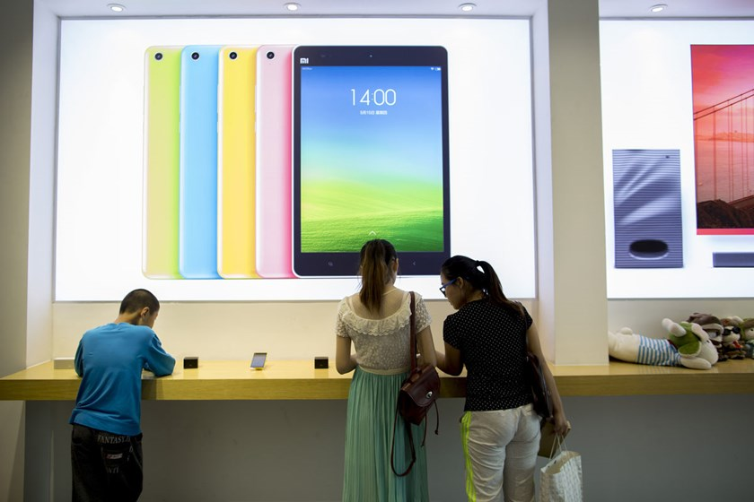 Customers look at Xiaomi Corp. products at the company's showroom in Beijing, China, on Sept. 12, 2014.