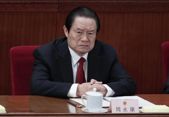 Former China's Politburo Standing Committee Member Zhou Yongkang attends the closing ceremony of the National People's Congress (NPC) at the Great Hall of the People in Beijing March 14, 2012.