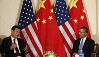 China's President Xi Jinping speaks during his meeting with U.S. President Barack Obama (R), on the sidelines of a nuclear security summit, in The Hague March 24 2014.