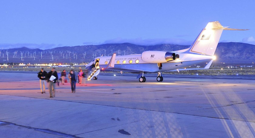Members of the National Transportation Safety Board (NTSB) arrive before dawn at the Mojave Air and Space Port in Mohave, California, on Nov. 1, 2014.