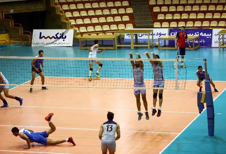 Iran's national volleyball team take part in a training session at Azadi sports hall in Tehran on July 8, 2014