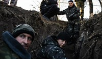 Pro-Russian separatists sit in a trench at a check point near the village of Frunze, eastern Ukraine, on November 4, 2014