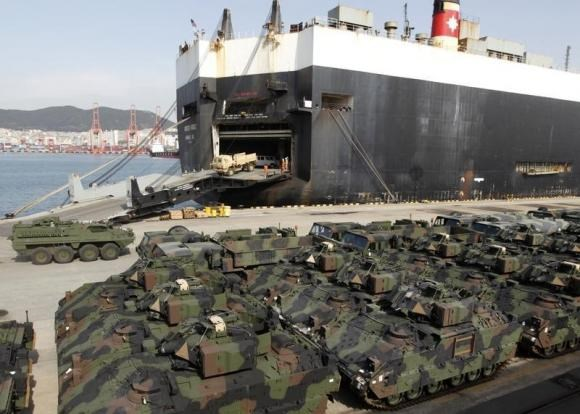 Vehicles of the 1st Battalion, 21st Infantry Regiment of the 2nd Stryker Brigade Combat Team, 25th Infantry Division of the U.S. Army are unloaded from MV Green Ridge at Pier 8 in Busan, about 420 km (262 miles) southeast of Seoul, March 20, 2012.