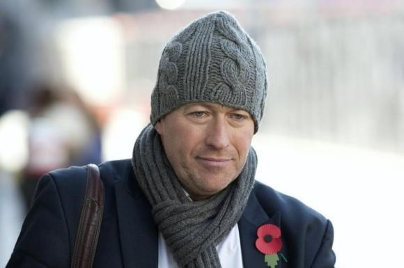 Ian Edmondson, former news editor at the News of the World arrives at the Old Bailey courthouse in London October 30, 2013.